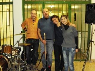 Da sinistra verso destra: Andrea Brunelli, Andrea Celidoni, Giulia Torbidoni e Marika Profiliall'interno del carcere di Barcaglione