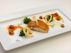 Ombrina in crosta di polenta e porcini, cicoria saltata e raguse in porchetta
