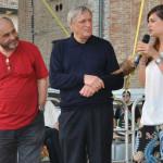 Chantal Bomprezzi sul palco dell'asta della legalità con Don Luigi Ciotti e Don Tonio Dall'Olio