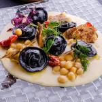 Tortelli di rana pescatrice con crema di ceci e chips di coppa marchigiana- ricetta di Marco Iacchetta